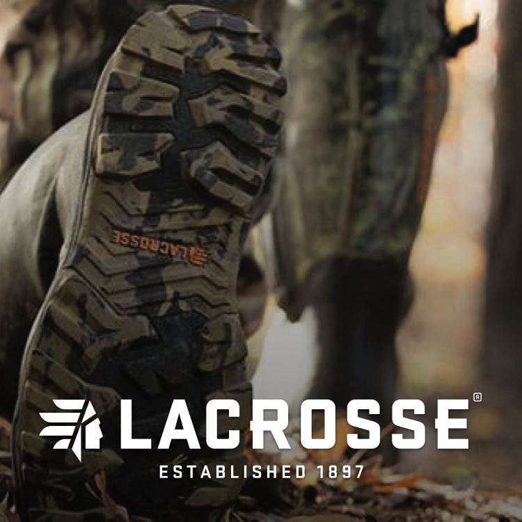 Lacrosse boots stepping in leaves walking in woods with logo